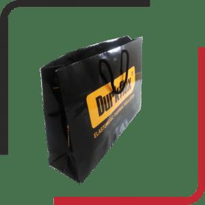 پاکت گلاسه دسته دار 01 300x300 - طراحی و چاپ انواع پاکت بیرون بر - پاکت حمل - پاکت حمل کرافت - یکجاپک